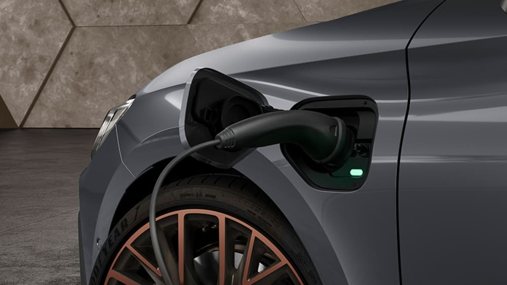 new-cupra-leon-sportstourer-ehybrid-family-sports-car-in-rodium-grey-closeup-view-of-charging-plug-for-emission-free-driving